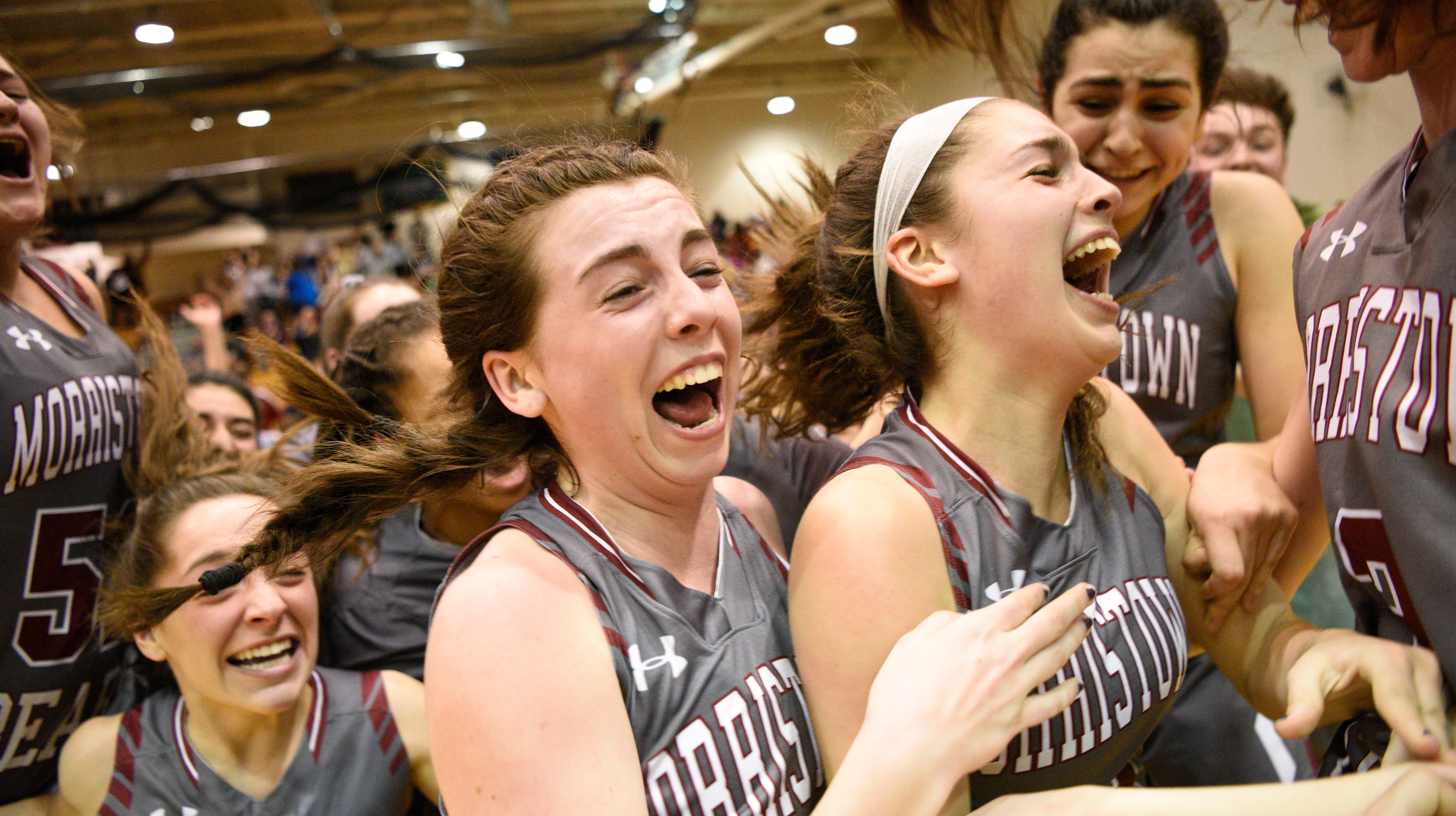 Chatham vs. Morristown-Beard in the Morris County Tournament girls basketball final at the County College of Morris in Randolph on Friday, February 22, 2019. (center)  MB #24 Bridget Monaghan celebrates with MB #25 Christina De Mattheis after Mattheis scored the game-winning basket.