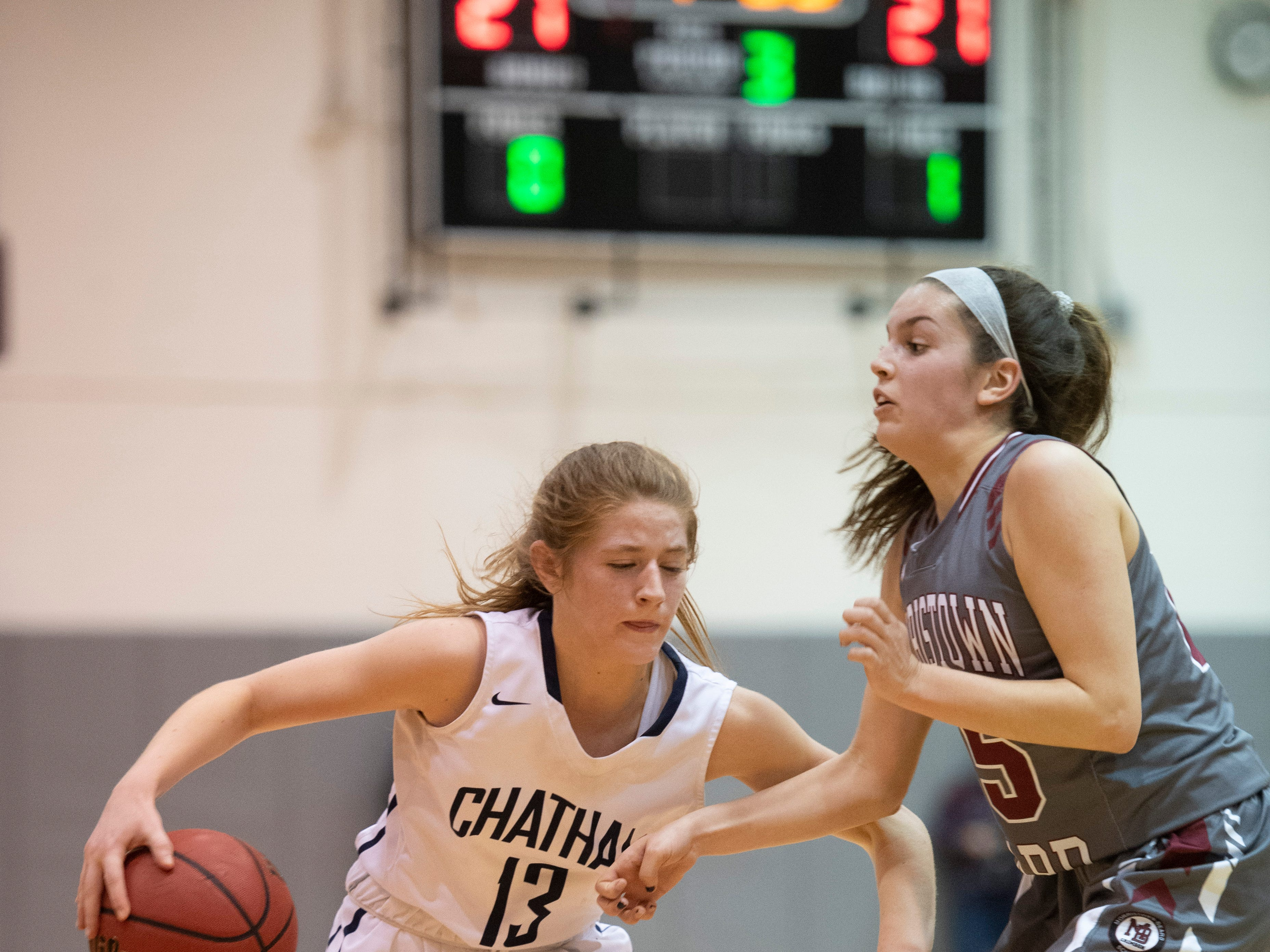 Chatham junior Maddie Hartnett tries to get past Morristown-Beard's Christina DeMattheis during the Morris County Tournament girls basketball final at County College of Morris in Randolph on Friday, February 22, 2019.