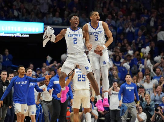 Kentucky guards Keldon Johnson (3) and Ashton Hagans (2) celebrate during the game against the Auburn Tigers in the first half at Rupp Arena on Feb. 23, 2019.