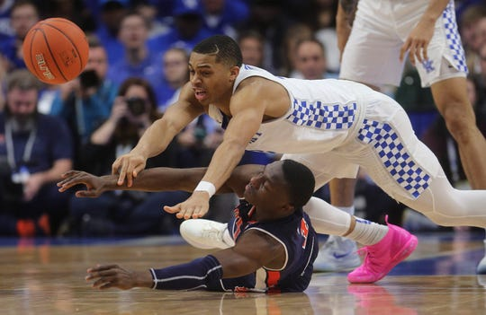 Kentucky guard Keldon Johnson (3) and Auburn guard Jared Harper (1) dive for a loose ball in the second half at Rupp Arena on Feb. 23, 2019.