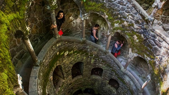 Climbing the dry wells of Quinta da Regaleira.