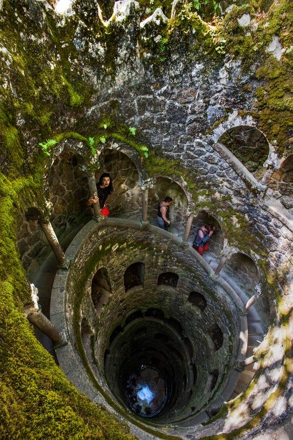Climbing the dry wells of Quinta da Regaleira.