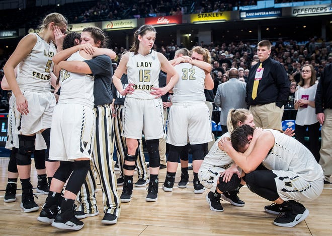 Winchester reacts after being defeated by Oak Hill 54-42 during their state final game at Bankers Life Fieldhouse Saturday, Feb. 23, 2019.