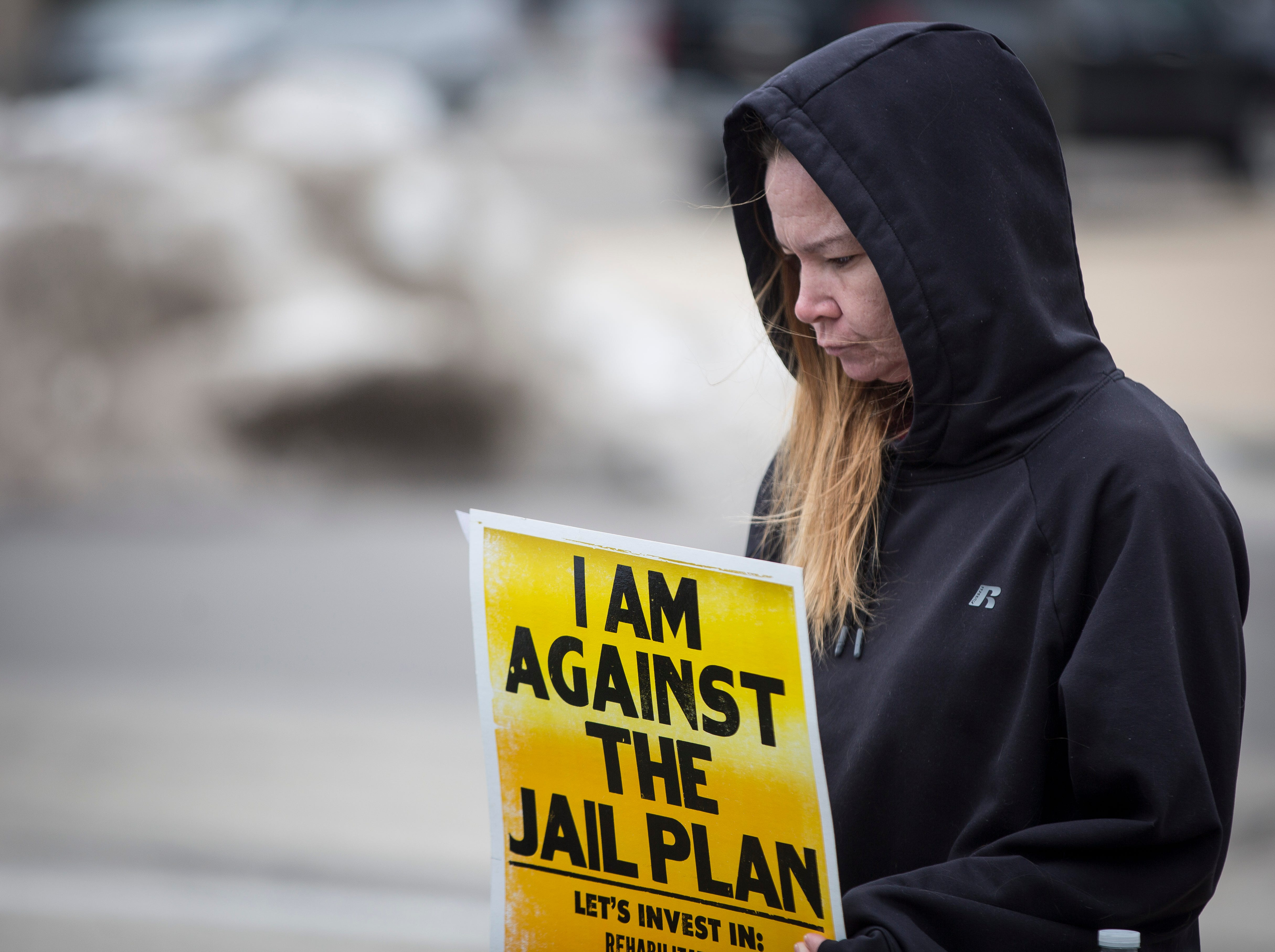 Members of the public raise signs and speak about their objections to the Delaware County jail project during a grassroots public assembly on Saturday in front of the Delaware County Justice Center. The project finances will be voted on during the county council meeting on Tuesday.