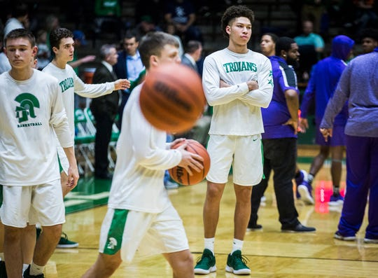 New Castle's Mason Gillis, shown here watching warmups before a game against Central, has missed the entire season after undergoing knee surgery over the summer.