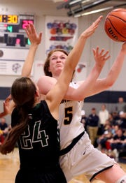 PCA's AC Markham (5) goes up for a shot as Knoxville Webb's Megan Gilbert (24) guards her on Friday, Feb. 22, 2019.