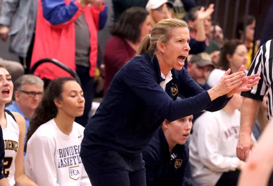 Providence Christian coach Tara James guides her team during the DII-A state tournament.