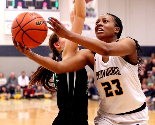 PCA's Yaubryon Chambers (23) goes up for a shot as Knoxville Webb's Megan Gilbert (24) guards her, on Friday, Feb. 22, 2019.