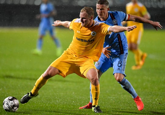 Nashville SC midfielder Matt LaGrassa (20) takes the ball away from New York City FC midfielder Alexander Ring (8) during the first half at First Tennessee Park Friday, Feb. 22, 2019 in Nashville, Tenn.