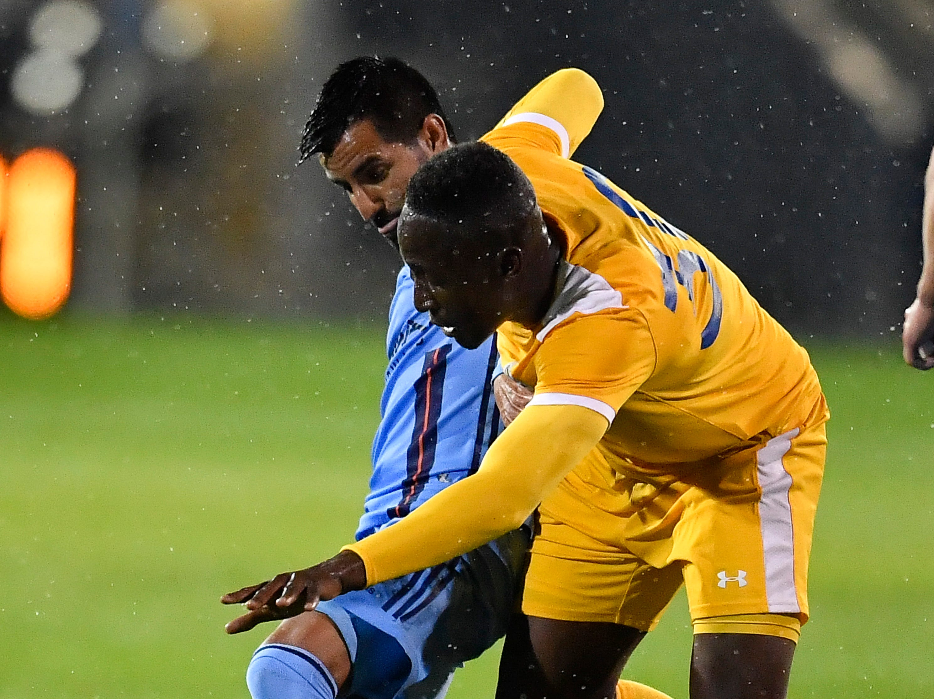 Nashville SC midfielder Bolu Akinyode (30) battles a New York City FC defender for the ball during the first half at First Tennessee Park Friday, Feb. 22, 2019 in Nashville, Tenn.