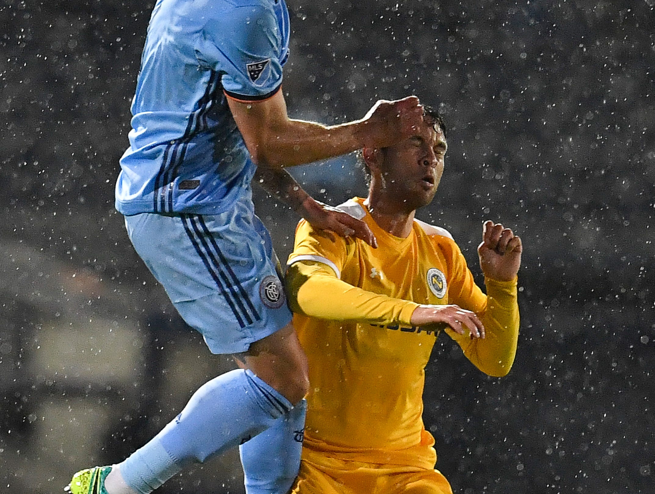 New York City defender Maxime Chanot (4) heads the ball over Nashville SC forward Cameron Lancaster (9) during the first half at First Tennessee Park Friday, Feb. 22, 2019 in Nashville, Tenn.