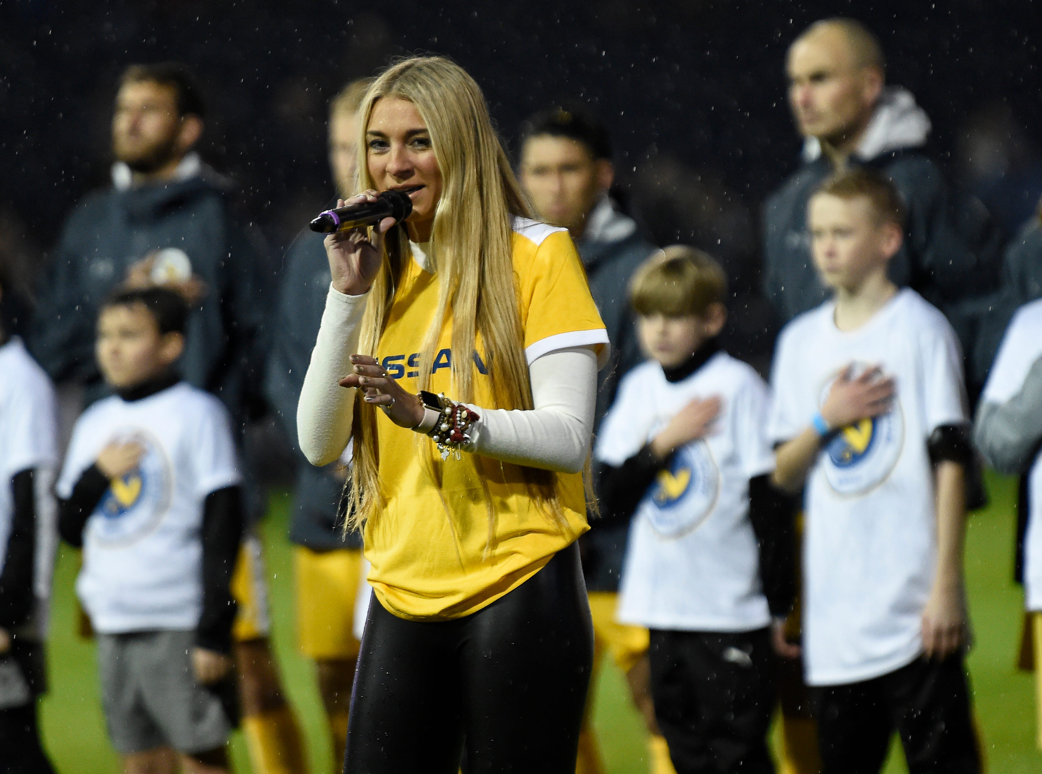 Julia Cole sings the National Anthem before the preseason game between Nashville SC and New York City FC at First Tennessee Park on Friday, Feb. 22, 2019 in Nashville, Tenn.