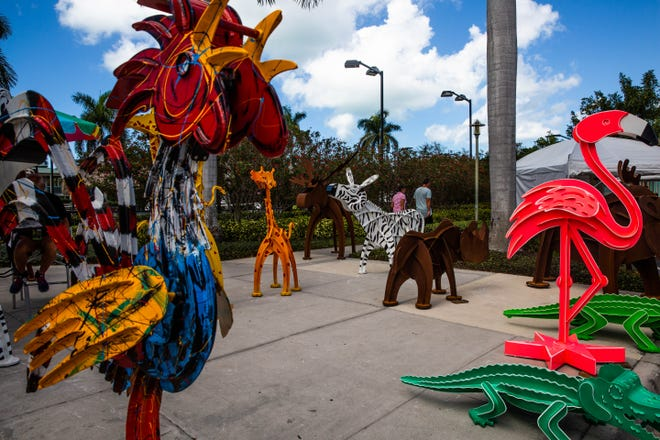 Colorful sculptures crafted by Santa Fe artist Fredrick Prescott line the walkway of the Naples National Art Show, an outdoor art show at Cambier Park in Naples on February 23, 2019.