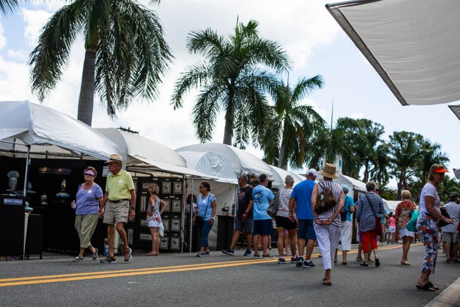Tents of art line downtown Naples Feb. 23, 2019 during a Naples National Art Show produced by Naples Art. This year, the United Arts Council is producing one as well, which has ignited  conflict.