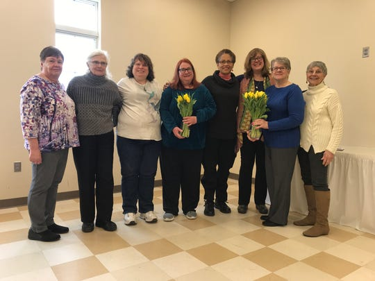 West Milford's public library hosted a Feb. 23 book reading featuring seven women, who recently participated in a memoir writing workshop led by local author N. West Moss (third from right).