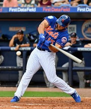 Feb 23, 2019; Port St. Lucie, FL, USA; New York Mets left fielder Tim Tebow (15) grounds out in the fifth inning at First Data Field.