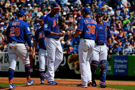 New York Mets manager Mickey Callaway (36) removes New York Mets relief pitcher Walker Lockett (61) in the second inning against the Atlanta Braves at First Data Field.
