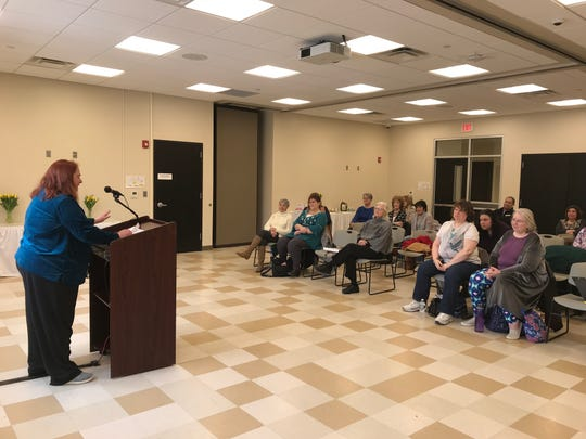 Kalyn Shaible, 61, of West Milford (far left) reads her story at the West Milford public library during a Feb. 23 book reading. The event featured seven women, who recently participated in a memoir writing workshop led by local author N. West Moss.