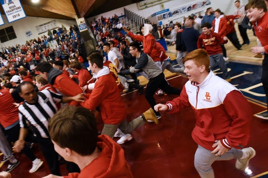 Bergen Catholic beats Don Bosco at the finals of 63rd Bergen County Jamboree boys basketball tournament at Fairleigh Dickinson University in Hackensack on Friday February 22, 2019. Bergen Catholic fans rush the court to celebrate their win.
