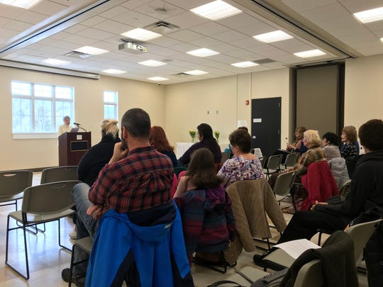 Marge Dooley, 81, of West Milford (far left) reads her story at the West Milford public library during a Feb. 23 book reading. The event featured seven women, who recently participated in a memoir writing workshop led by local author N. West Moss.