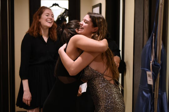 The Tom Coughlin Jay Fund Foundation is teaming up with Bloomingdale's at the Short Hills Mall to provide prom dresses cancer patients and survivors in Short Hills on Friday February 22, 2019. Megan Rappleyea looks on as Natalie Bayer, 17 from Kearney and Michelle Franko, 18 from North Arlington share a hug.