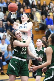 Wayne Valley vs. DePaul in the Passaic County Girls Basketball Tournament Final at Wayne Valley High School on Saturday, February 23, 2019. WV #4 Steph LaGreca drives to the basket as D #22 Riley Sikorski defends.
