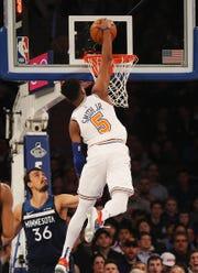 Feb 22, 2019; New York, NY, USA; New York Knicks guard Dennis Smith Jr. (5) dunks the ball as Minnesota Timberwolves forward Dario Saric (36) looks onduring the first half at Madison Square Garden.