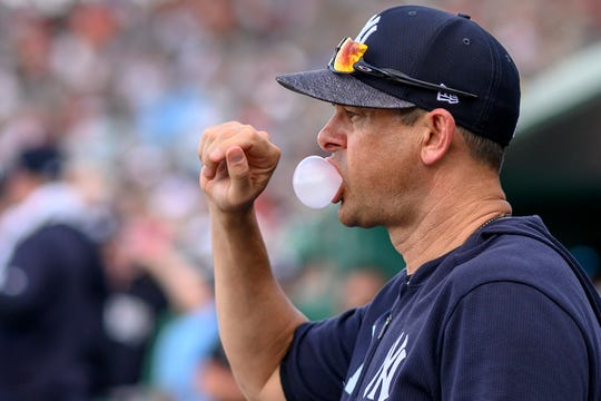 New York Yankees manager Aaron Boone (17) looks on while blowing a bubble during the game against the Boston Red Sox at JetBlue Park.