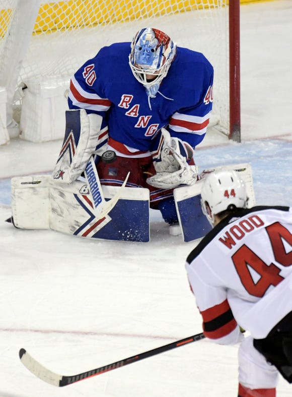 New York Rangers goaltender Alexandar Georgiev (40) stops a shot by New Jersey Devils left wing Miles Wood (44) during the third period of an NHL hockey game Saturday, Feb. 22, 2019, at Madison Square Garden in New York. The Rangers defeated the Devils 5-2.