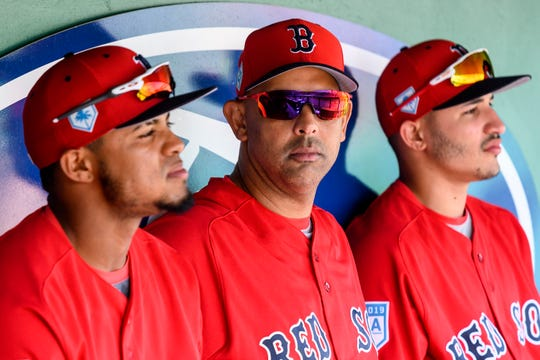 Boston Red Sox manager Alex Cora (center) looks on prior to the game between the Boston Red Sox and the New York Yankees at JetBlue Park.