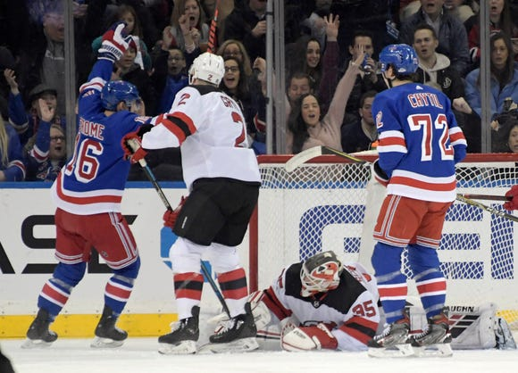 New York Rangers center Ryan Strome (16) celebrates his goal against New Jersey Devils goaltender Cory Schneider (35) as Devils defenseman Eric Gryba (2) and Rangers center Filip Chytil (72) look on during the first period of an NHL hockey game Saturday, Feb. 22, 2019, at Madison Square Garden in New York.