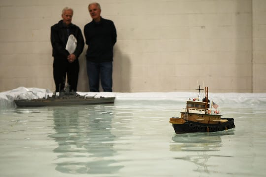 The Academy of Model Aeronautics (AMA) hosts the annual AMA Expo East at the Meadowlands Exposition Center in Secaucus on Saturday February 23, 2019. Two men watch as model boats cross in front of them.