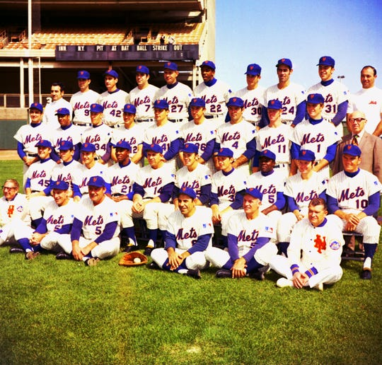 A team photo of the 1969 World Champion New York Mets.  From left, front row: trainer Gus Mauch, coach Joe Pignatano, coach Rube Walker, coach Yogi Berra, coach Eddie Yost, assistant trainer Joe Deer.  second row: Tug McGraw, Garey Gentry, Al Weis, Cleon Jones, manager Gil Hodges, Jerry Grote, Bud Harrelson, Ed Charles, Rod Gaspar, Duffy Dyer.  THIRD ROW: Jim McAndrew, Tommie Agee, Cal Koonce, Ken Boswell, Tom Seaver, Jerry Koosman, Ron Swoboda, Wayne Garrett, Bobby Pfell, traveling secretary LouNiss.  TOP ROW: equipment manager Nick Torman, J.C. Martin, Ron Taylor, Ed Kranepool, Don Cardwell, Donn Clendenon, Nolan Ryan, Art Shamsky, Jack DiLauro, clubhouse Roy Neuer.