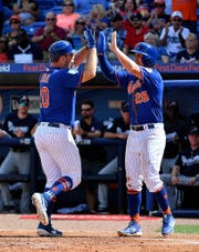 Feb 23, 2019; Port St. Lucie, FL, USA; New York Mets first baseman Peter Alonso (20) celebrates his home run in the second inning against the Atlanta Braves with Third baseman J.D. Davis (28) at First Data Field.