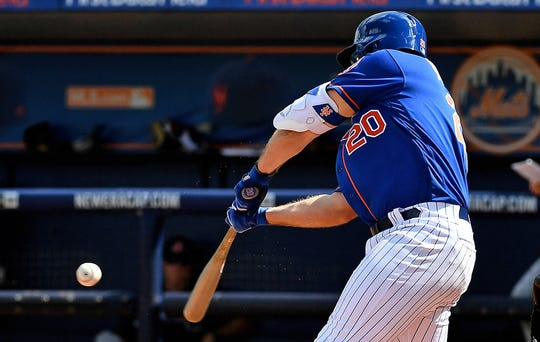 Feb 23, 2019; Port St. Lucie, FL, USA; New York Mets first baseman Peter Alonso (20) connects for a two run home run in the second inning against the Atlanta Braves at First Data Field.
