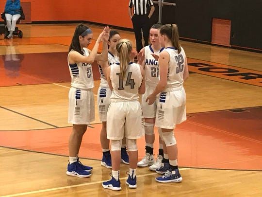 Holy Angels starters huddle to pump up each other prior to the start of the second half in Friday's inaugural Bergen County girls basketball invitational final at Fort Lee.