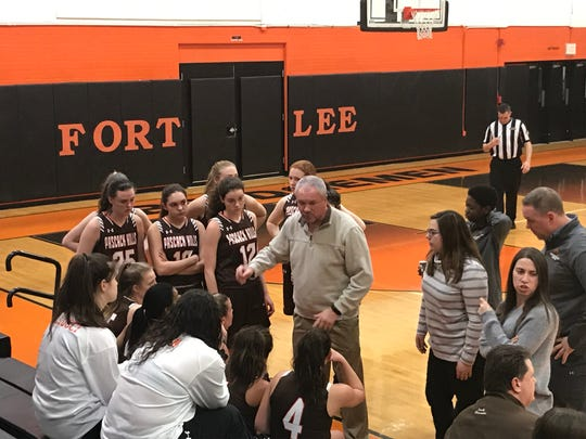 Pascack Hills girls basketball coach Scott Ernest talks to his team during a time out from the Bergen County invitational final at Fort Lee on Friday, Feb. 22, 2019. The Cowgirls fell to Holy Angels, 50-21, to finish runner-up in the inaugural event.