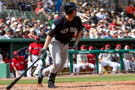 New York Yankees first baseman Greg Bird (33) singles to right field during the third inning against the Boston Red Sox at JetBlue Park.