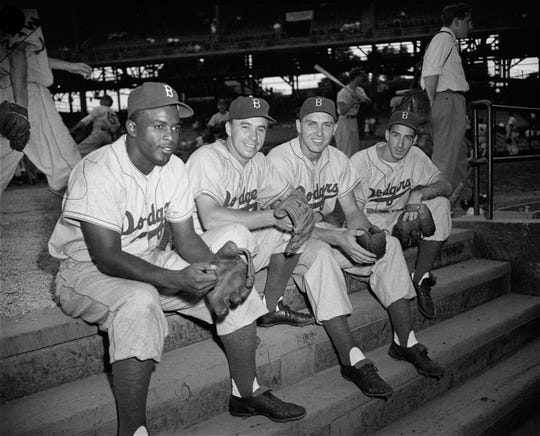 These four fellows are one of the reasons that the Brooklyn Dodgers are in a close race race with the St. Louis Cardinals.  Left to right are:  Jackie Robinson, second base; Pee Wee Reese, shortstop; Gil Hodges, first base; and Billy Cox on third, August 2, 1949.