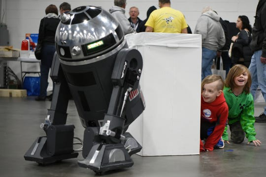 The Academy of Model Aeronautics (AMA) hosts the annual AMA Expo East at the Meadowlands Exposition Center in Secaucus on Saturday February 23, 2019. Brayden Yonchuk, 8 and Logan Corley, 6 hide from a R4K5 droid from Droid Builders.
