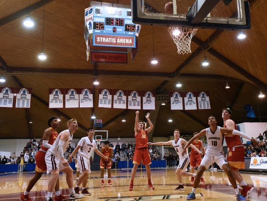 Zach Freemantle (shooting) and Bergen Catholic, shown here in the Bergen Jamboree final against two-time defending champion Don Bosco, won division, county, sectional and state boys basketball titles.