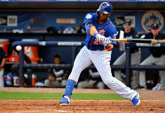 Feb 23, 2019; Port St. Lucie, FL, USA; New York Mets designated hitter Robinson Cano singles in the third inning against the Atlanta Braves at First Data Field.