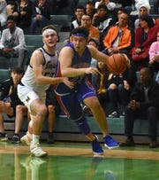 Las Cruces High's Salvador Nevarez drives to the basket against Mayfield on Friday at Mayfield High.