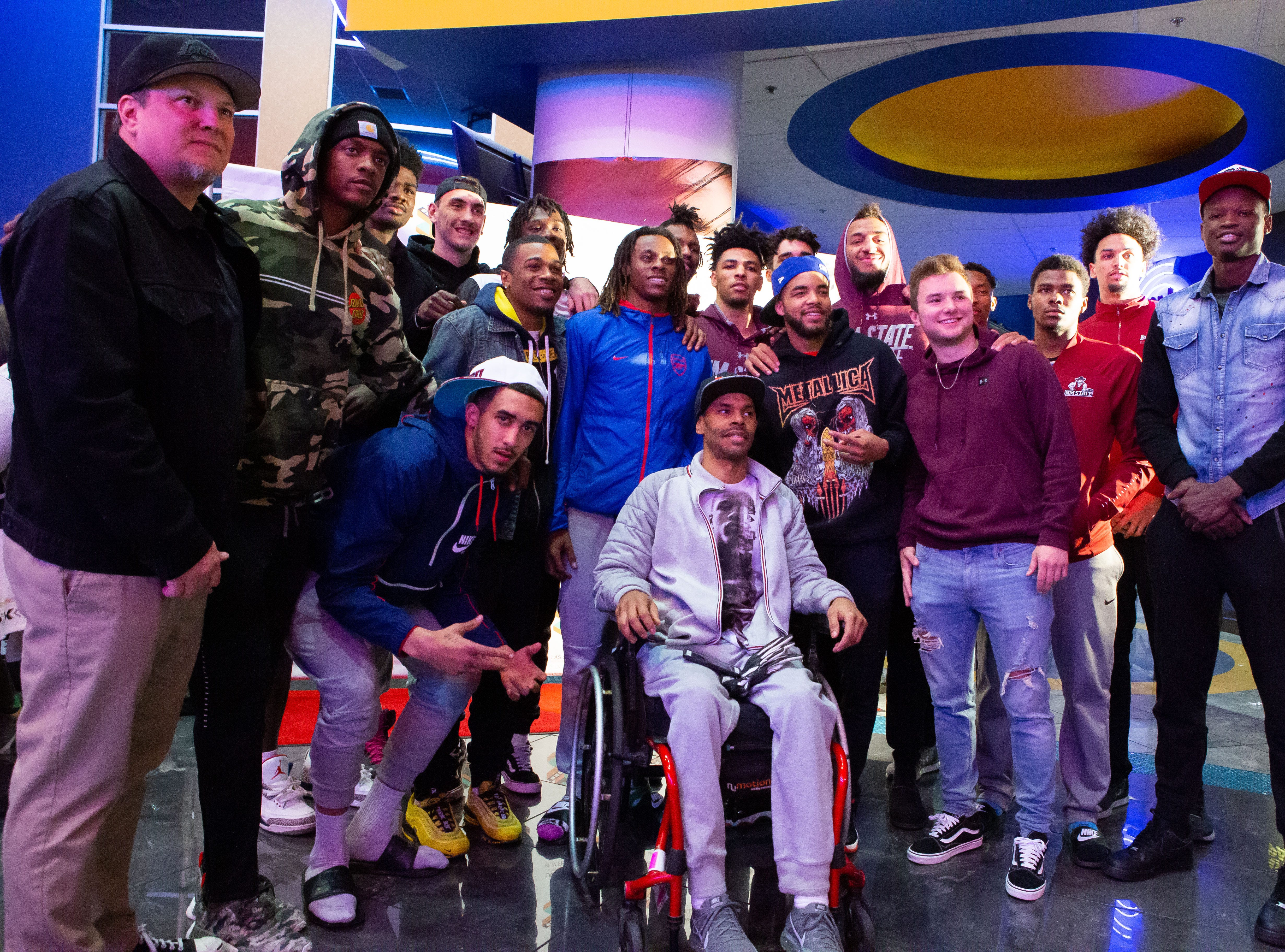 """Former New Mexico State basketball player Shawn Harrington takes a photo with the NMSU Aggies men's basketball team. The Aggies attended the """"Chi-Town"""" documetary at the LCIFF on Friday."""