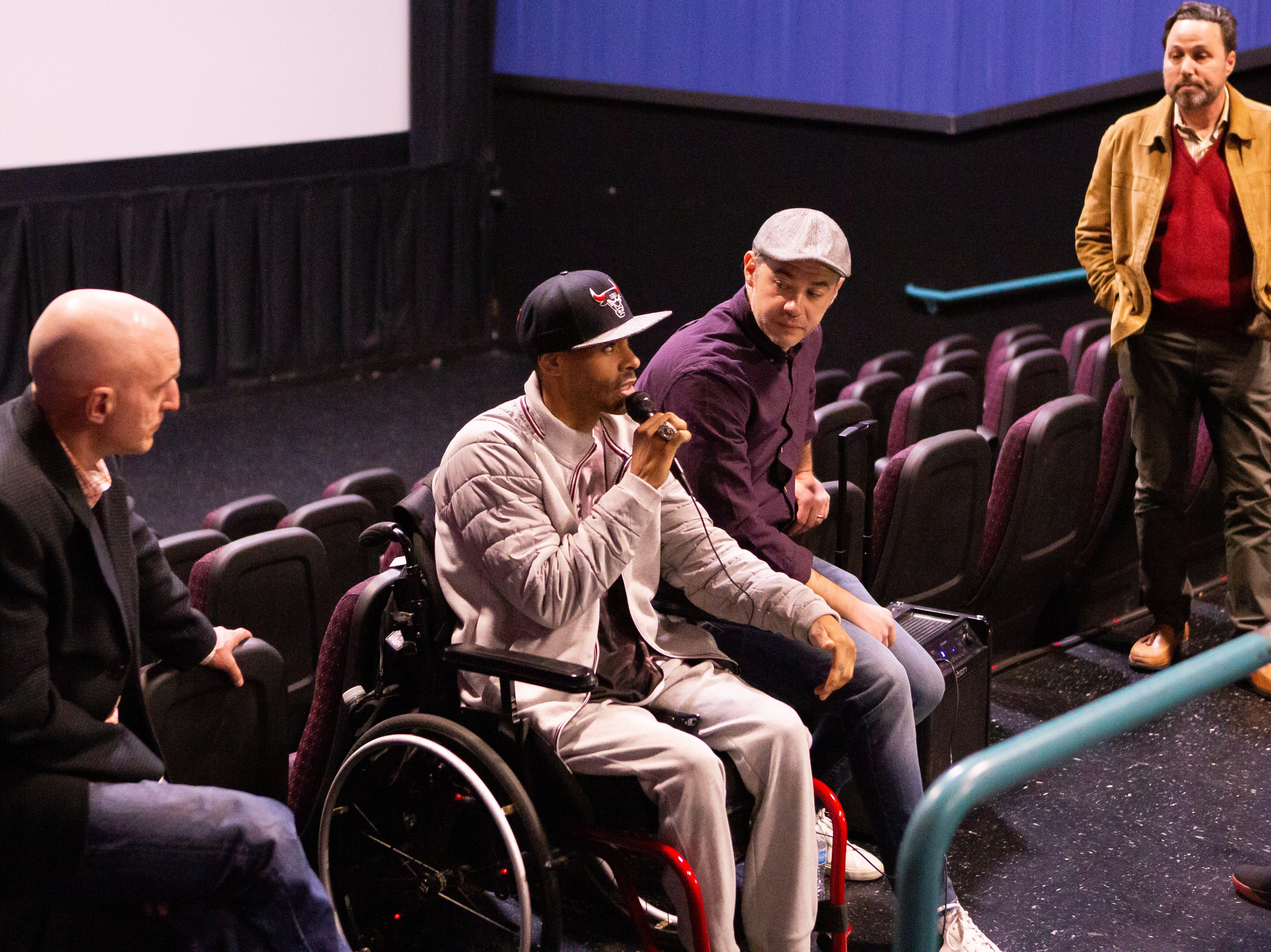 """Shawn Harrington discusses """"Chi-Town"""" documentary. Also pictured are far left, author Rus Bradburd, film director Nick Budabin and LCIFF Executive Director, Ross Marks on Friday night."""