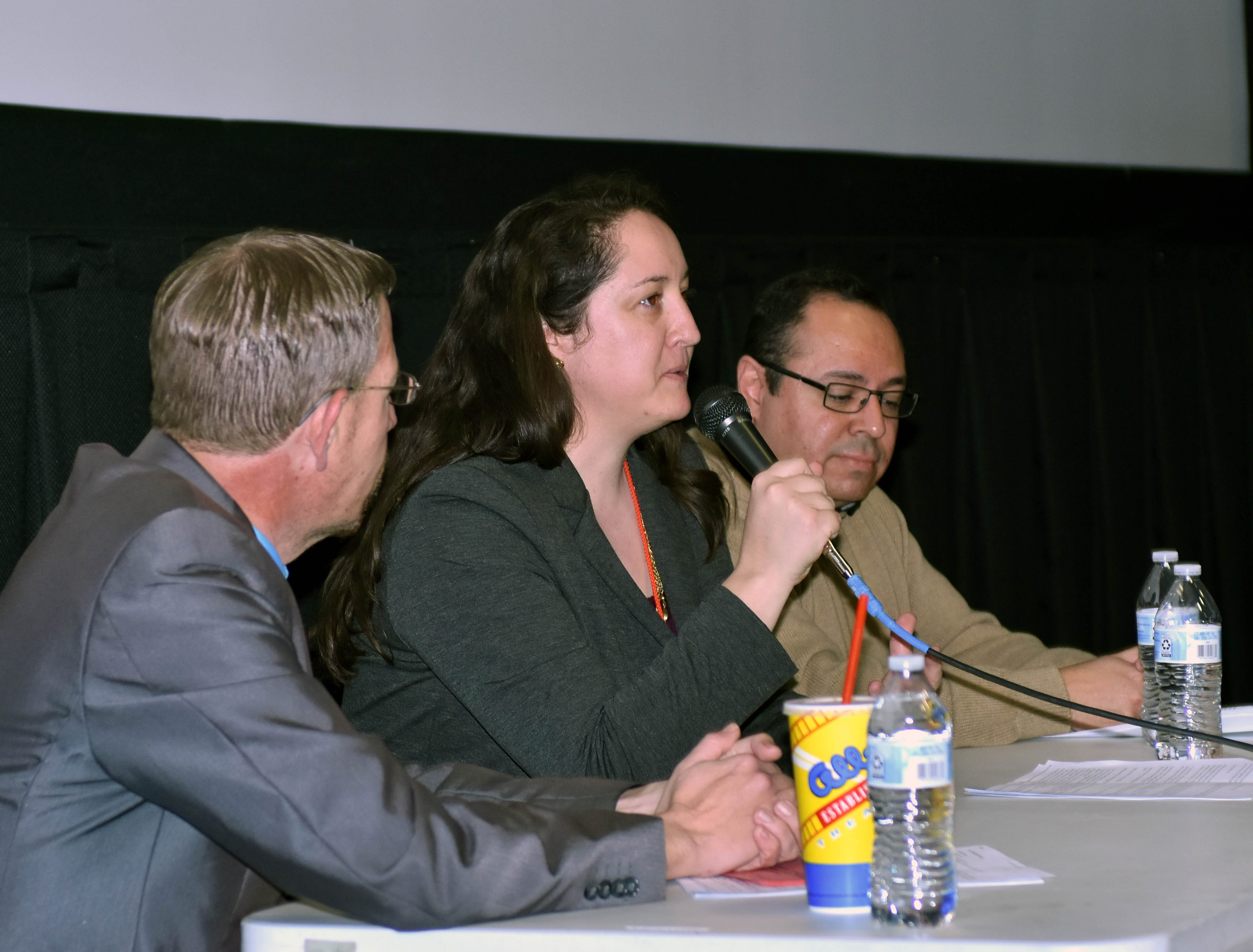 """Las Cruces Sun-News reporter Diana Alba Soular participates in a discussion following the screening of """"The Wall"""" on Saturday, Feb. 23, 2019, at Cineport 10, part of the Las Cruces International Film Festival. Damien Willis, left, moderated the panel featuring Alba Soular and El Paso Times reporter Daniel Borunda, right."""