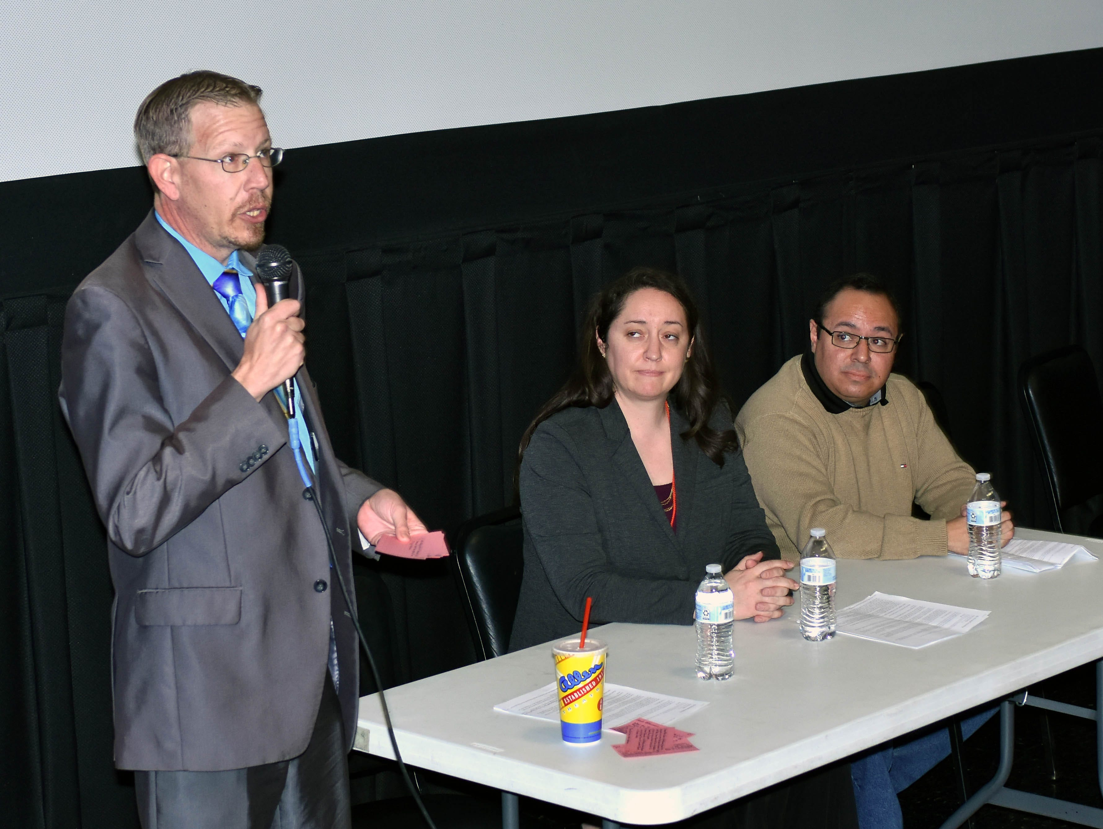 """Damien Willis, Las Cruces Public Schools public information officer, moderates a discussion following a screening of """"The Wall"""" Saturday, Feb. 23, 2019, at Cineport 10, part of the Las Cruces International Film Festival. Las Cruces Sun-News reporter Diana Alba Soular, center, and Daniel Borunda, right, were the panelists."""