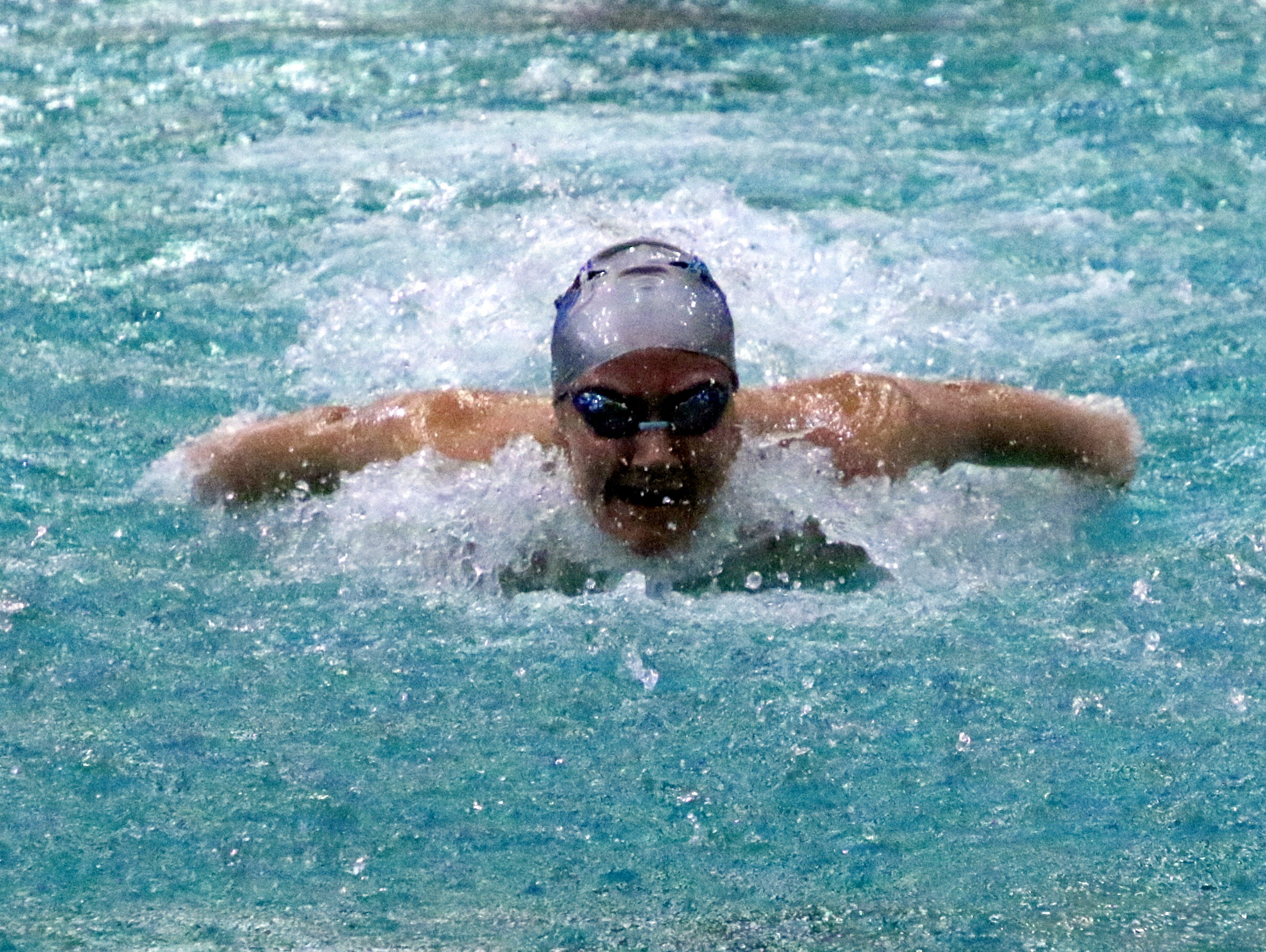 Carlsbad's Izabella Morgan swims the butterfly during the 200-yard girls medley relay on Friday. The Cavegirls finished 16th with a time of 2:04.38.