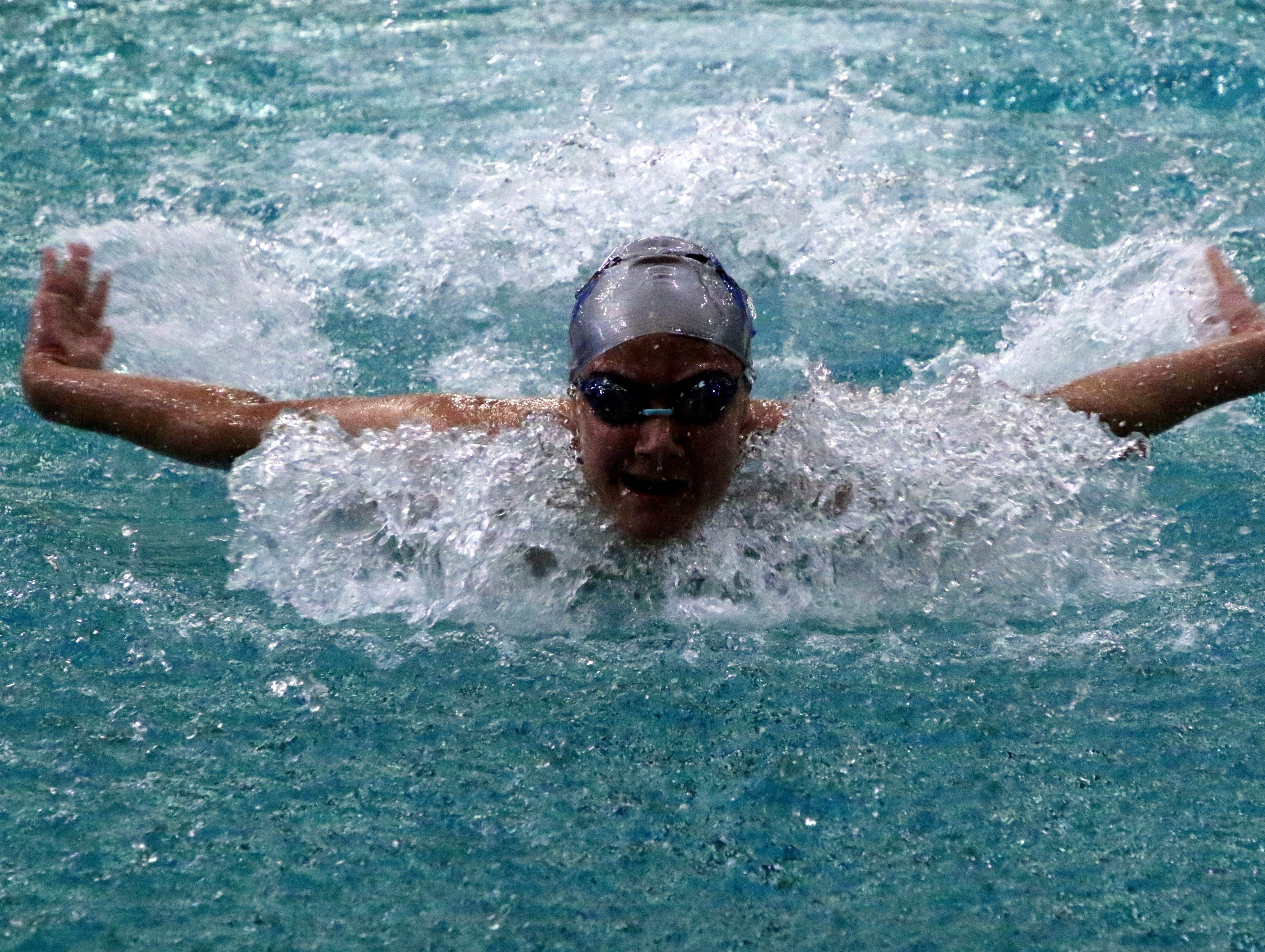 Carlbad's Izabella Morgan swims the butterfly portion of the 200-yard medley relay on Friday.