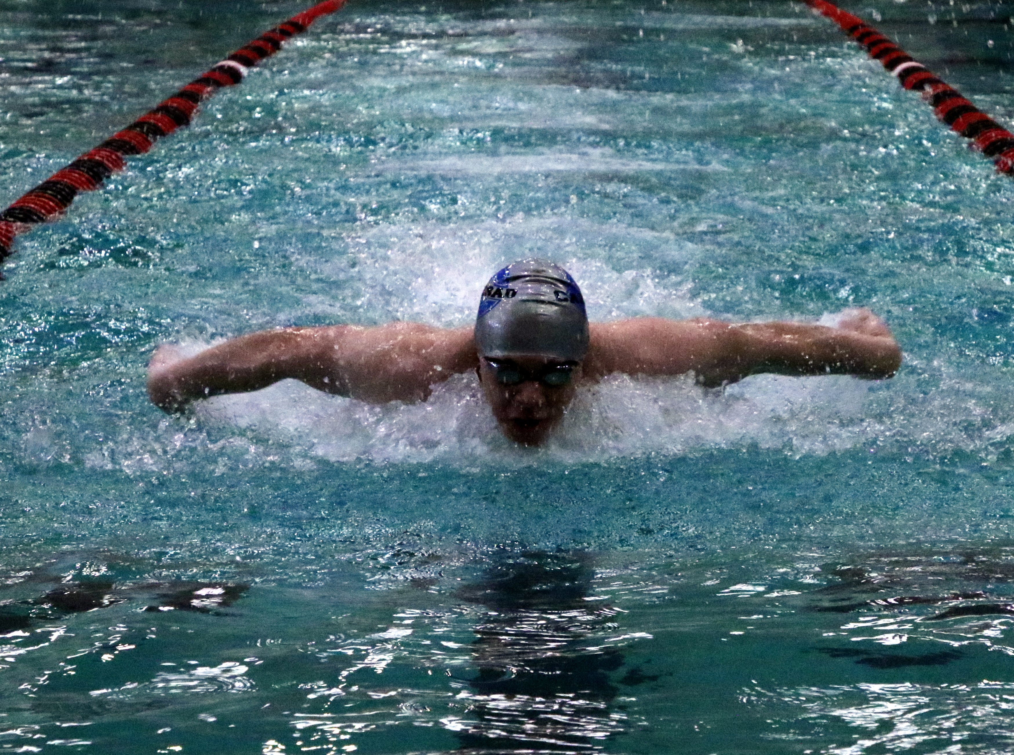 Carlsbad's Matthew Pavlik swims the butterfly during the 200-yard medley relay on Friday.
